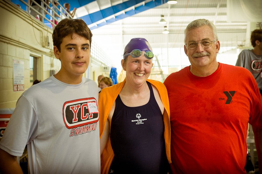 DP Swimmer volunteer Jake Meisenheimer, Erin and Coach Larry.