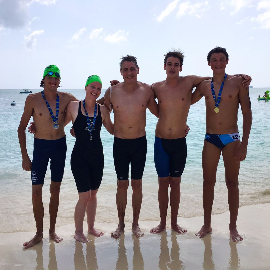 Congratulations to Gregg Dedic who represented the United States S.O. open water swimming team for his excellent swim in the one mile Flowers Sea swim held in Grand Cayman.  Gregg finished 187 out of over 900 swimmers.  Also in the photo is Nathalie Nickson (coach Apryle's daughter) who was Gregg's united partner in the swim (186th) Coach Lucky (46th) and coach Lucky's son's Jake (10th place) and Max (95th)
